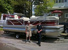 pontoon boat loaded on trailer