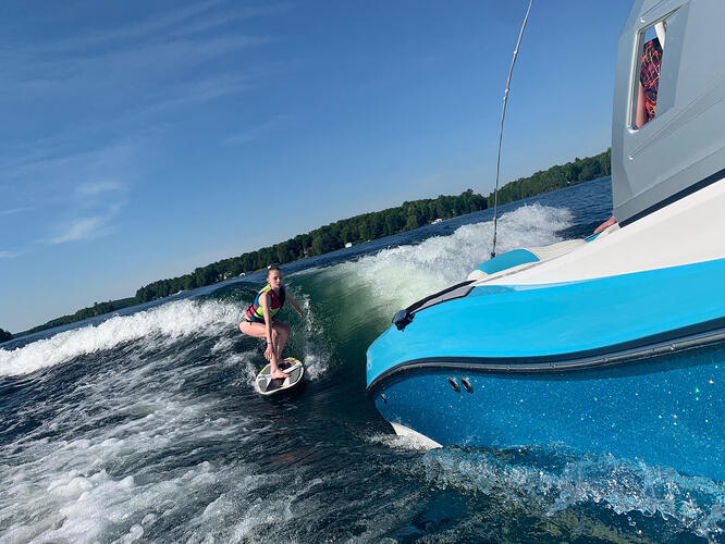 wakesurfing and being towed by a boat